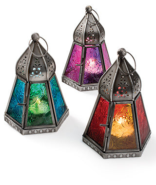 Three different coloured Moroccan lanterns which hold one tealight each