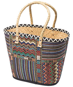 This stylish multi-use bag from Vietnam consists of a woven palm leaf body and handles, with a colourful embroidered outer skin.