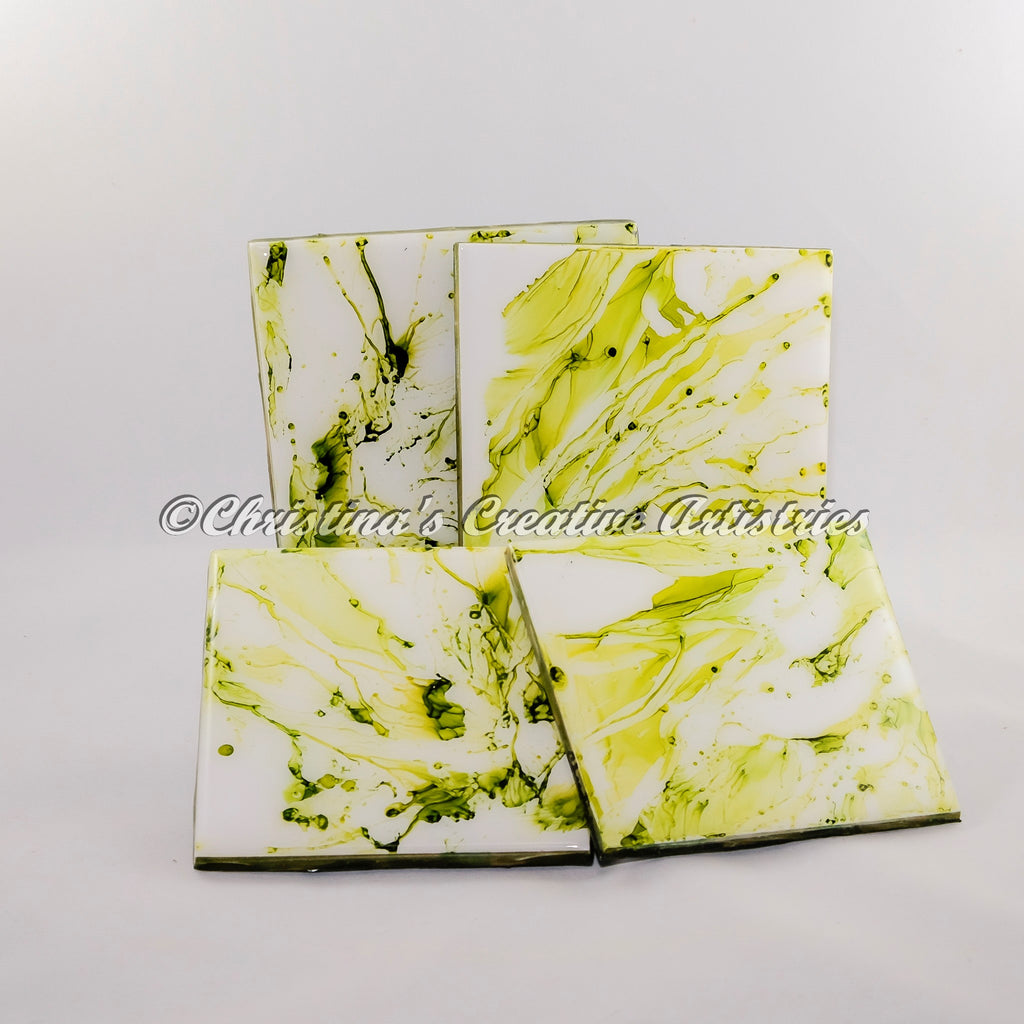 Celery Bloom Ceramic Coasters product image.  Features 4 x4 inch handpainted ceramics.  Set of 4 coasters.  Each coaster has its own unique design.  Durable coating.  Cork- backed.  Any occasion gift.