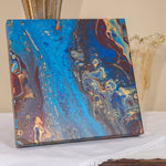 "Pacific Jewel by Christina Russell features original artwork.  One-of-a-kind .  Acrylics in dark red, gold and metallic blue.  Measures 12"" x12"".  Wrapped Canvas.  Modern. Comes ready to hang"