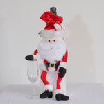 Leggy Santa bottle bag features a Santa wine bag with adjustable arms and legs.  Add a bottle of your favorite drink for your party and sit him on the edge of the table.  His dangling legs will amuse your guest.  Makes a great host or hostess gift for the holidays.
