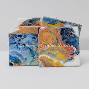Canyon Wall Ceramic Coasters product image.  Features set of 4 x 4 ceramic tile coasters.  Hand-painted. Acrylics in navy and light blue, amber, orange on a white background.  Unique designs. Coaster stand included.