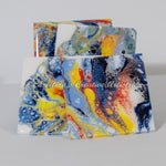 Color Dramaz Features a set of 4 coasters. Ceramics.  Hand painted.  Acrylics.  Colors are  light blue, dark blue, yellow, orange, white.  Durable coating.  Cork backed.  Coaster stand included.  Art on tile. Perfect for holding your cold drinks.   Protects your table tops from watermarks. Unique housewarming gift.
