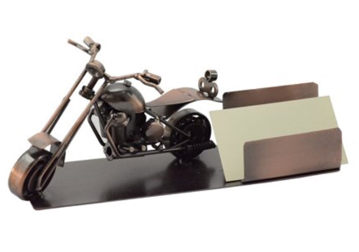 "Motorcycle Business Card Holder features chopper motorcycle and card holder on a metal plate. handcrafted with recycle metal. Color is bronze with copper accents.  Measures 8""x3""x4"".  Holds up to 100 standard size business cards.  Stylish. Unique. Desk top decor.  Great accent for home or work office."