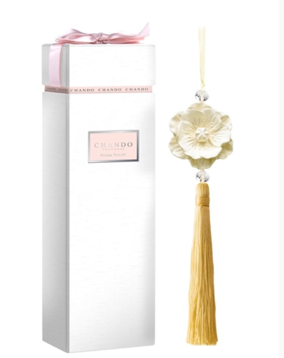 Chando Ornament Collection--Warm Tulips features 1 elegant porcelain flower ornament with attached hanger and tassel. 1 5ml alcohol-free, warm tulip oil fragrance. Porcelain flower diffuser, tassel and hanger are yellow.  Beautiful packaging is white box, pink label, pink bow .  This diffuser never gets thrown away. Chando Refills available for sale.  Rinse flower ornament with alcohol to try a new fragrance.  Elegant. Decorative. Youthful.