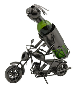 Motorcycle Rider Wine Bottle Buddy. A fully clothed individual with a bottle inserted as the body and the head a top the bottle riding a motorcycle.  Bottle not included.