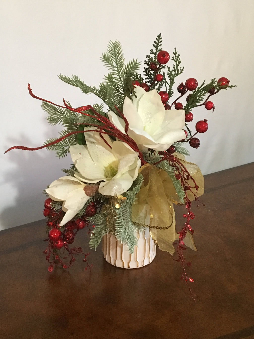 "Lady Mag product image features frosted and glittered magnolias, red berries, mixed pines branches, sheer gold ribbon, white and gold laced modern vase.  Measurements are 14'H x12"" W.  Ideal as a hostess gift, housewarming gift, gift for mom, Christmas gift for sister, Christmas gift for female boss."