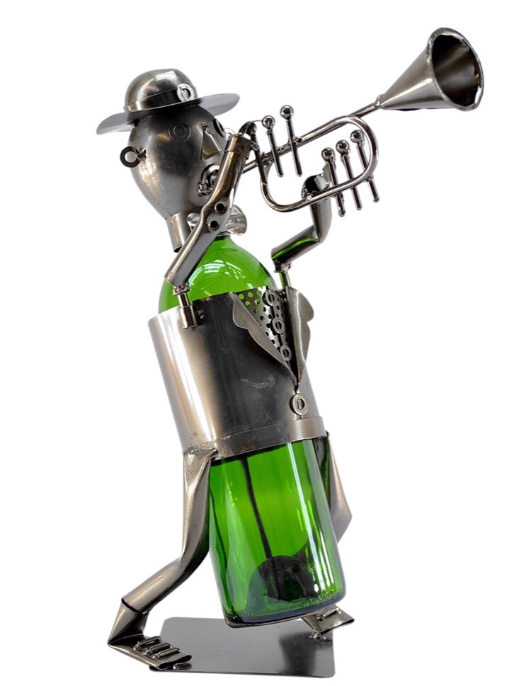 "Trumpet Player Wine Caddy features a metal, man playing a trumpet, standing table top.  Recycled metal.  Handmade.  Great kitchen decor.  Fabulous Mancave accessory.  Holds standard size round bottle. Measures 8""x 7.5""x10"""