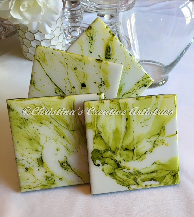 Celery Bloom Ceramic Coasters product image.  Features 4x4 inch hand painted ceramic coasters in celery green on white background.  Sold as a set of 4.  Cork backed.  Coaster stand included.