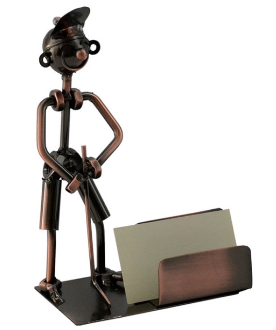 Golfer Business Card Holder features golfer wearing a cap, holding a putter, standing next to business card holder.  Color is bronze.  Material is recycled metal.  Handcrafted. Unique. Decorative. Fun gift for golf enthusiast.  Great desk top accessory.  Holds up to 100 business cards.