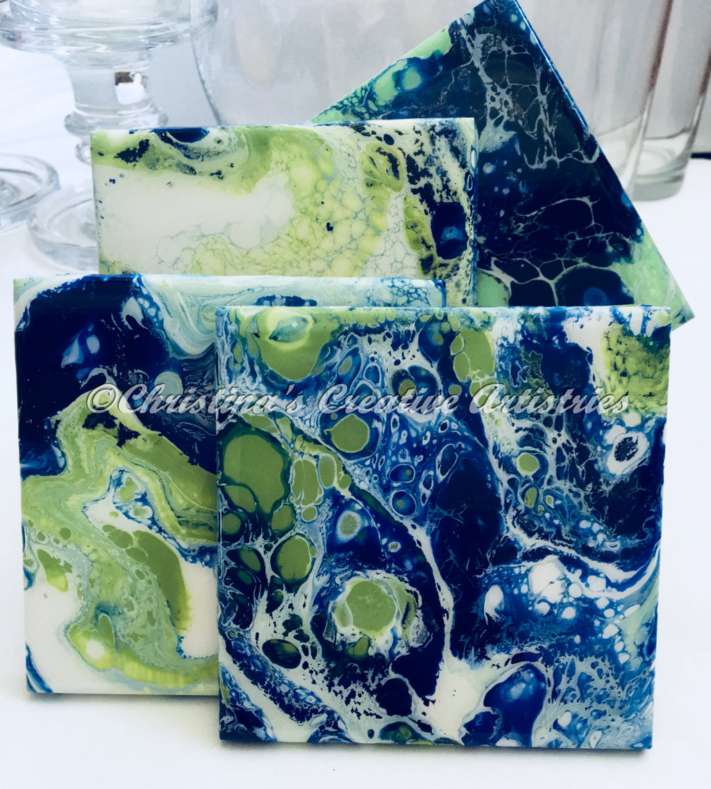 Blue Martini ceramic coasters product image.  Features blue and green painted in a funky contemporary design. 4x4 coasters. Acrylics in blue and green.  Durable coating. Coaster stand included.