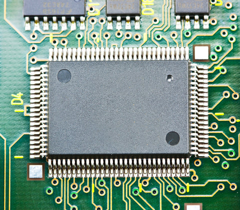 Silicon or silicone? This computer circuit chip is made of silicon, an efficient semiconductor. Credit: ninsiri | Shutterstock.com