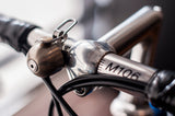 silver spur cycle bell on bike handlebars