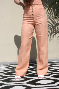 PALOMA WOOL Adeline Linen Pants in peach button front summer resort wear style