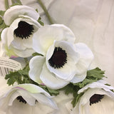 a white anemone silk flower