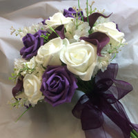 a brides ivory and purple artificial wedding flower bouquet