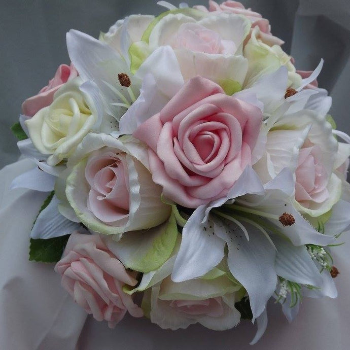 an artificial wedding bouquet of pink and ivory flowers