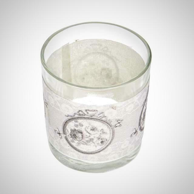 A round glass tealight holder with vintage rose decoration