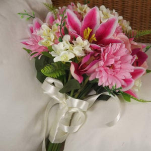 A brides bouquet of artificial silk roses, hydrangea gerbera and lily flowers