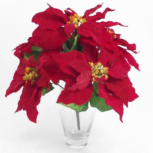 A red velvet artificial christmas poinsettia bush