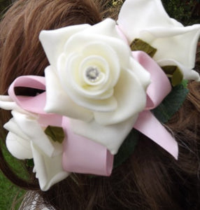 a bridesmaids hair comb of ivory roses (choice of ribbon colour)