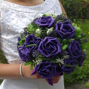 brides wedding posy bouquet of purple foam roses