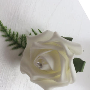 a pack of 6 ivory foam rose buttonholes with asparagus fern