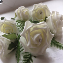 pack of ivory foam rose buttonholes