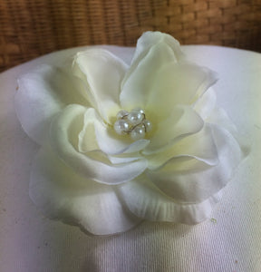 A large ivory rose on metal hair comb with pearl centre