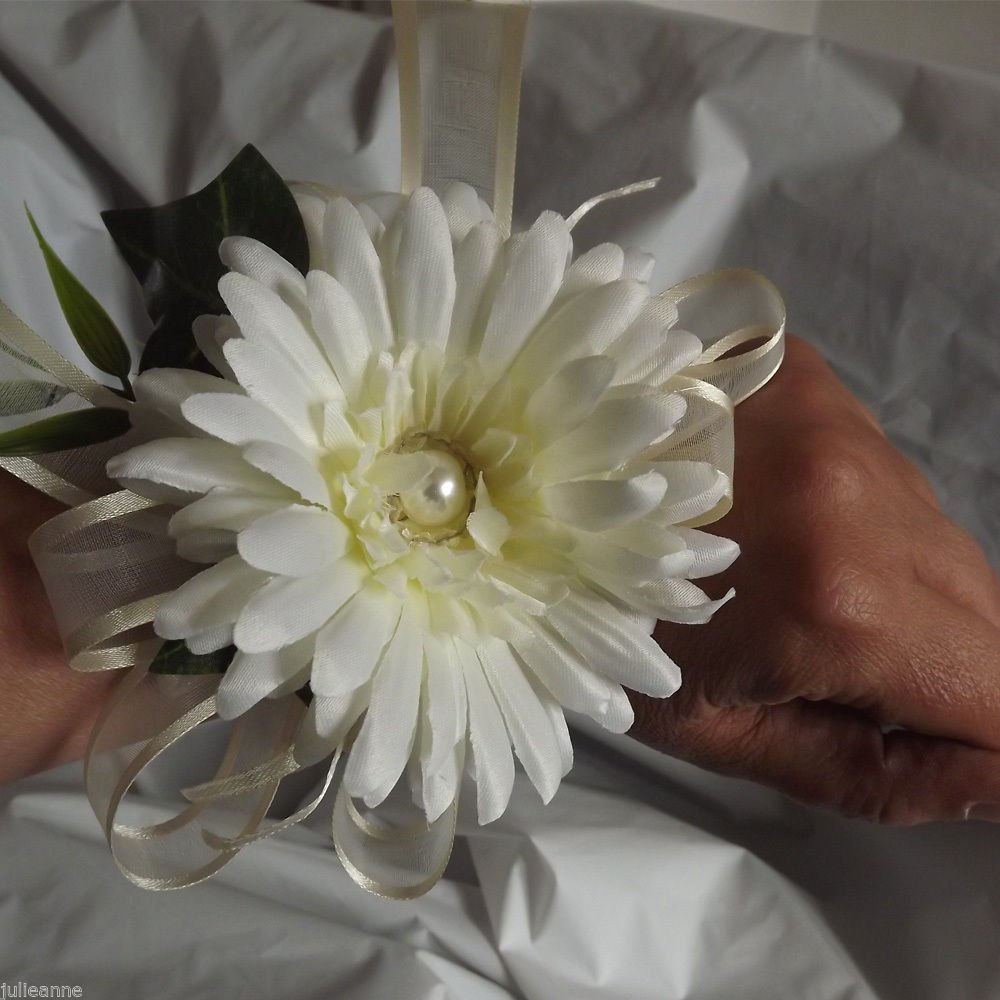 WRIST CORSAGE - an ivory artificial silk gerbera with ribbon bow & foliage