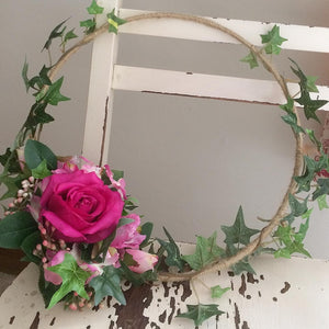 a rustic flower hoop featuring artificial silk roses & ivy