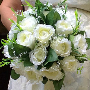 brides bouquet of artificial ivory roses