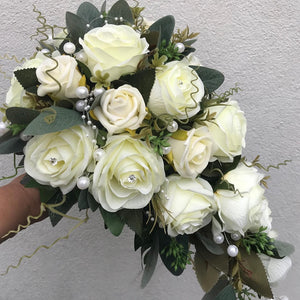 A wedding bouquet collection of ivory roses and pearls