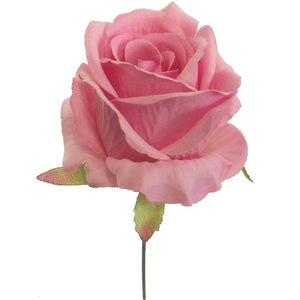 an artificial pink silk full blown rose flower