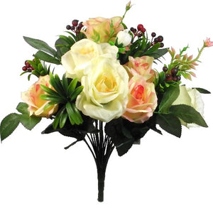 a mixed artificial flower bouquet in shades of yellow and peach