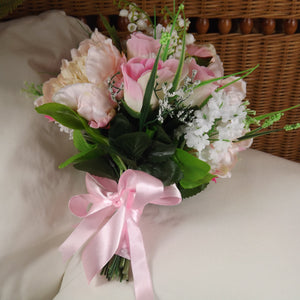 an artificial wedding bouquet of artificial pink rose, peony & pure white lily of the valley