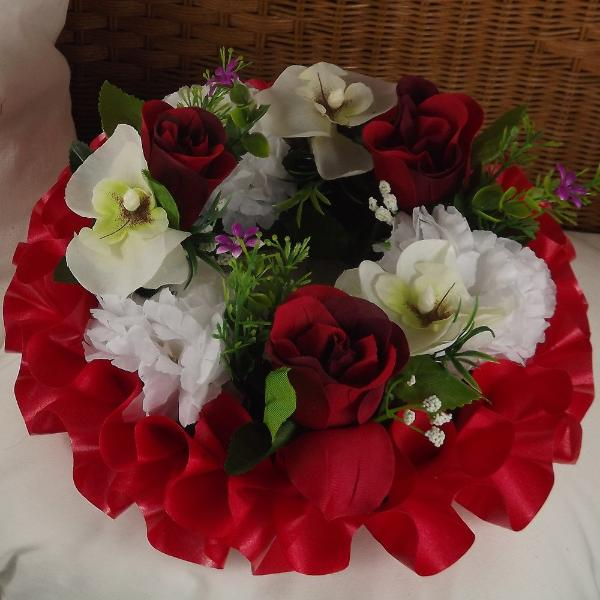 memorial wreath of artificial silk roses and orchids in shades of red
