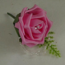 an artificial foam rose wedding buttonhole with pearl loops & asparagus fern