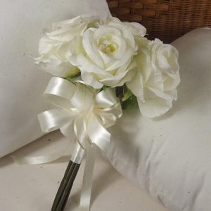a wedding posy featuring large ivory open roses