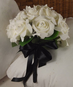 a brides bouquet of ivory artificial foam roses with diamante and pearls