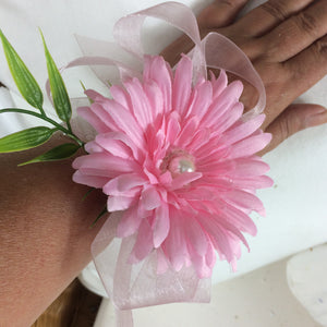 WRIST CORSAGE- a Pink artificial silk gerbera with ribbon loops & foliage