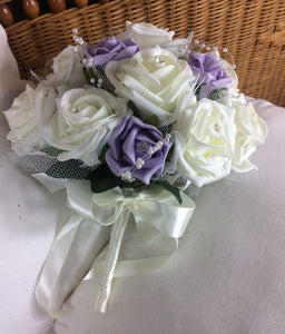 A wedding bouquet collection of lilac and ivory foam roses, pearls and diamante