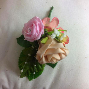 pink and peach artificial corsage