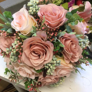 wedding bouquet of dusty pink roses