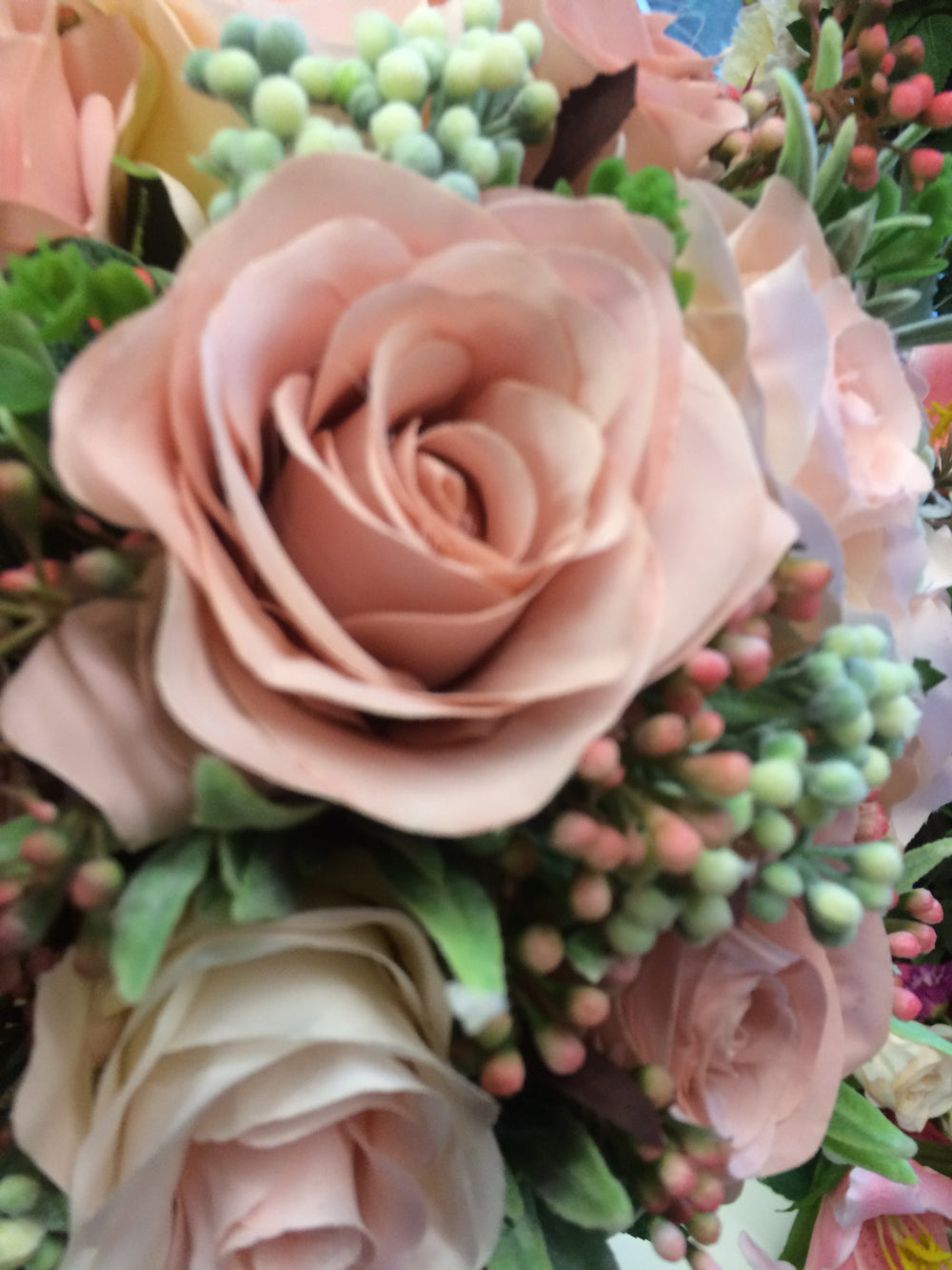 A Wedding Bouquet Of Dusky Pink Artificial Silk Roses And Foliage