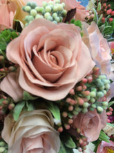 wedding bouquet of dusky pink artificial silk roses and foliage
