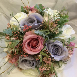 brides bouquet of lilac/grey and pink flowers