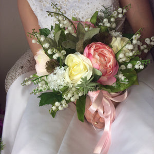 bridal bouquet of vintage pink and ivory flowers