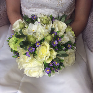 brides bouquet of silk ivory green and lilac flowers