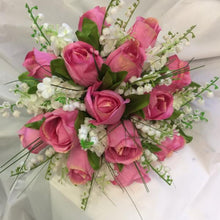 A wedding bouquet of artificial pink roses & pure white lily of the valley flowers